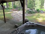 Hot tub on covered patio, walkway to deck overlooking Wenatchee River