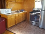Kitchen with new stainless steel stove and refrigerator