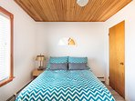 One of three bedrooms each with double size bed and feather duvet and pillows