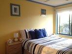 2nd bedroom, queen bed, garden view.