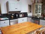 Spacious kitchen/dining room with lovely wood burning cooker range, electric oven and dining table.
