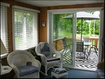 Beautiful sun room with shades.  Two seating areas on the deck.
