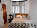 Bedroom one Features cable tv en-suite bathroom air con personal fridge in room kitchen Air con