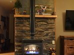 Thermostat controlled gas log fireplace for both warmth and ambiance.
