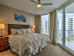 The master bedroom offers a king bed and access to the balcony.