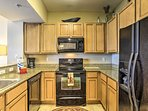 Prepare meals in the fully equipped kitchen with granite countertops.