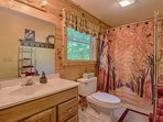 Both baths feature nice hot showers with strong water pressure. Clean, clean, clean! Towels provided