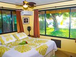 air-conditioned Master bedroom with view of the yard and lagoon