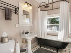 The Big 10 and Big 12 share a full bathroom with classic finishes.