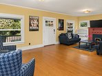 In the evening, enjoy the home's charm in the living room, which also features a large flat screen TV and DirectTV.
