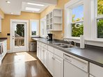 The light-filled kitchen has plenty of space for preparing group meals.