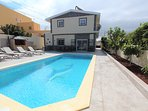 Pool with villa