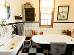 Full vintage inspired bathroom with original Victorian bath and full shower.