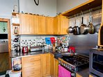 Modern kitchen with all appliances including a gas oven.