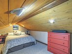 The loft features a queen bed and storage space for your belongings.