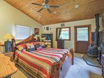 Retreat to the master bedroom for rest and relaxation.