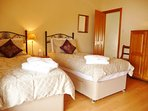 The front bedroom at Warrandyte enjoys views to the sea, Anglesey & Puffin Island