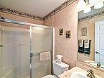 The master en-suite bathroom offers a walk-in shower.