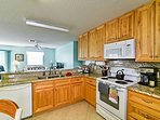 Modern appliances and ample counter space make cooking at home a breeze.