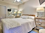 The master bedroom features a comfy queen-sized bed.