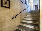 Staircase, with corresponding antique frames.