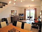 Living/dining room with air con, UK TV, Wi-FI and direct access to the the terrace and garden.