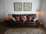 There is a comfortable leather 3 seater sofa, and two leather armchairs