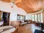 The Florida rm has cedar-lined ceilings, 2 ceiling fans, and tall casement windows lake views.
