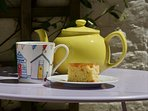 Tea and cake in the little yard at the back of Oriel Cottage.