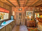 Exposed beams highlight this eclectic living space.