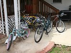 Bikes; 4 adults and 1 child bikes with helmets