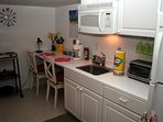 Kitchenette; breakfast nook , microwave, toaster oven, electric 2 stove burners. Furnished.