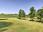 Surrounded by farm fields, this home is the perfect spot for your next reunion.