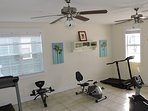 The fitness center is equipped with treadmills and stationary bikes.