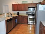 The kitchen has a microwave, dishwasher, toaster, Keurig, and regular coffee pot