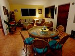 Colourfull dining room and lounge with t.v and extensive dvd library