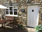The sun trap patio with table and chairs