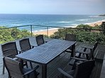 The ample front deck has loungers and table with chairs.  Guests spend most of their day here