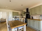 The spacious dining kitchen has an additional seating area making it a great social space