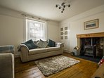 The homely lounge has a wood burning stove (on of two in the house), Sky TV and quality furnishings