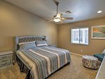Sleep tight in this spacious master bedroom, with a king bed.