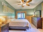 Light green walls complete this queen bedroom.