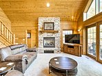Over 2,900 square feet of living space is featured in this cabin.