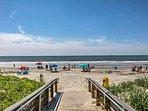 8 travelers will enjoy the short walk to the beach.