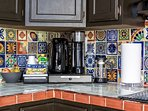 Our modern rustic kitchen features colorful handpainted Mexican talavera tiles.