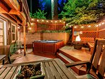 Relax in the evening on back hot tub area with fire ring and fence lighting