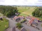 Aerial shot Hawkswood Country Estate and driving range