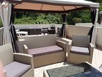 Gazebo area with Suite and Sun loungers at rear