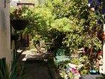 double bedroom has view of courtyard garden