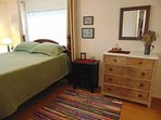 Master bedroom with comfy queen bed with memory-foam mattress.